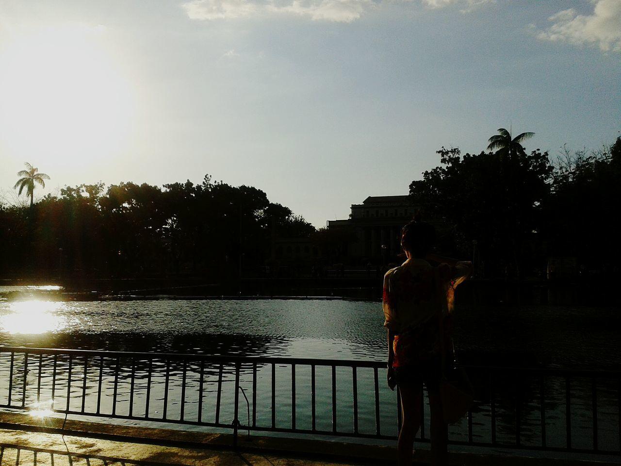 Woman Looking At River, Rear View