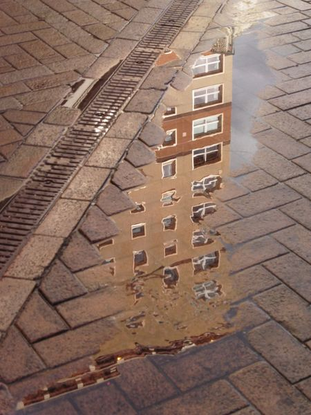 High Angle View Cobblestone Footpath No People Outdoors Day Streetphotography Reflection Reflection_collection Reflections In The Water Scotland Architecture Architecture_collection Tower High Rise Building High Rise Motherwell Flying High The Street Photographer - 2017 EyeEm Awards