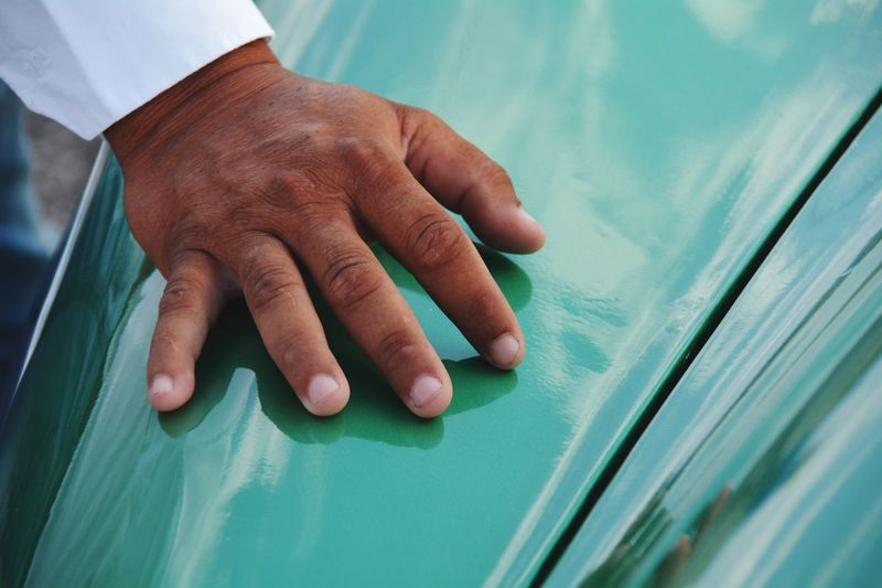 Cropped image of hand on vintage car