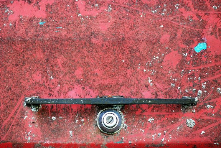 Close-up of handle on rusty metal