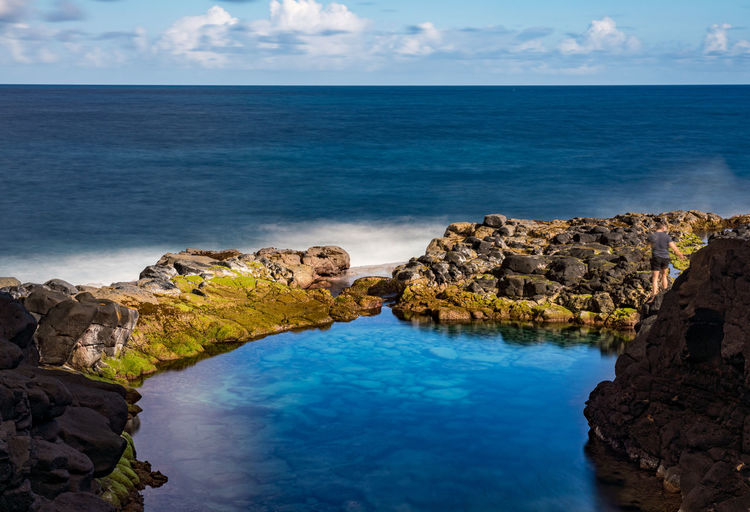 Long exposure of the calm waters of queen's bath, a rock pool off princeville on north kauai