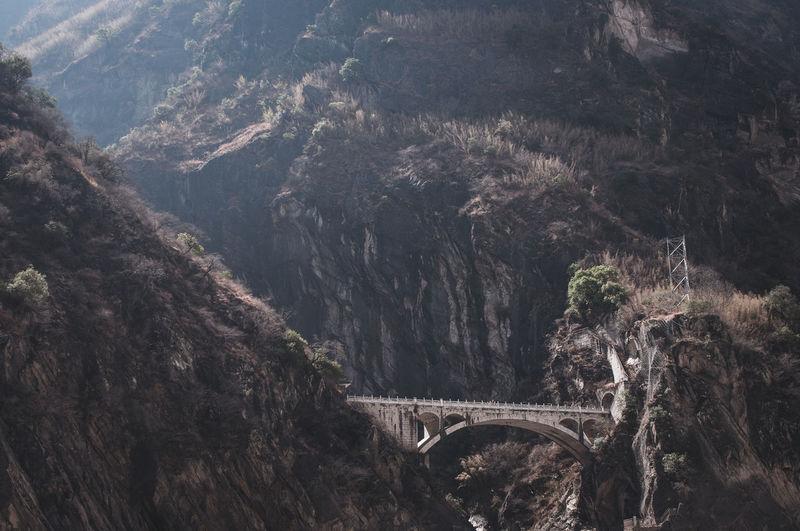 Aerial view of bridge over mountain