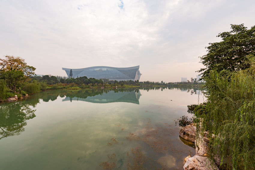 global center in chengdu Chengdu China Architecture Beauty In Nature Building Exterior Built Structure Cloud - Sky Day Global Center Growth Lake Mountain Nature No People Outdoors Plant Reflection Scenics - Nature Sky Tranquil Scene Tranquility Tree Water