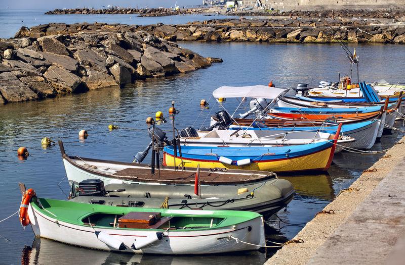 Boats moored on sea shore