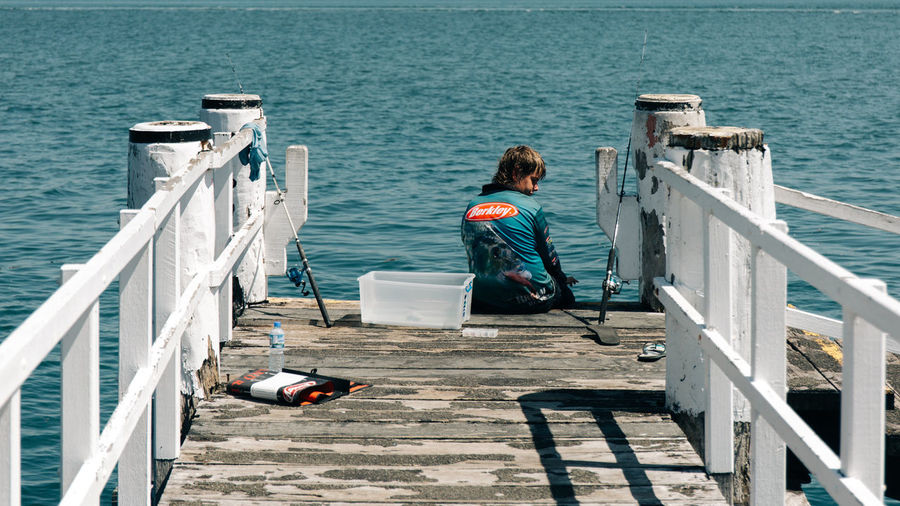 Water Railing Sea Full Length Real People Rear View One Person Lifestyles Nature Day Leisure Activity Pier Sunlight Adult Transportation Sitting Nautical Vessel Women Outdoors Looking At View Travel Street Streetphotography People