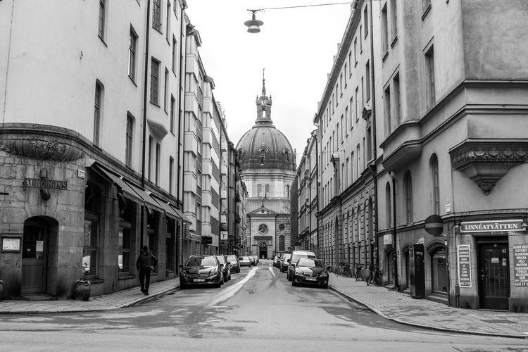 Road along buildings in city