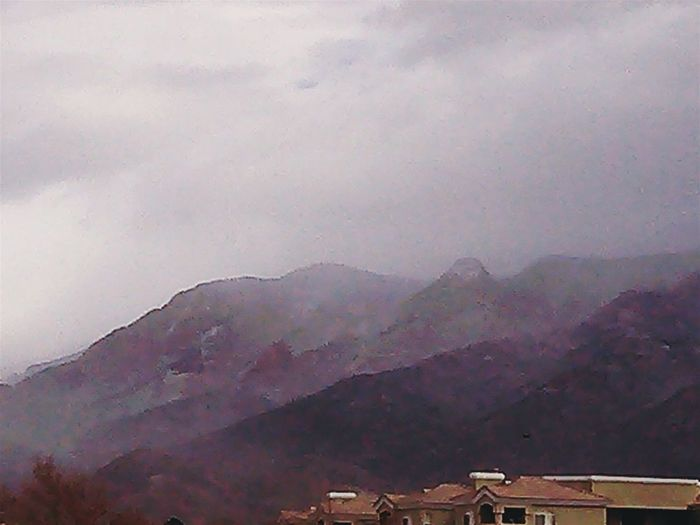 Picture of snow coming down on the Sandia Mountains