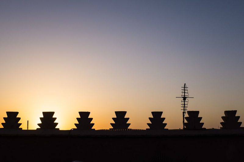 View of buildings and antenna at sunset