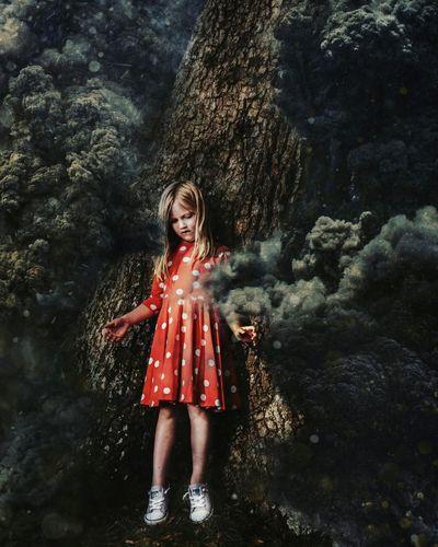Full length of a girl standing on rock