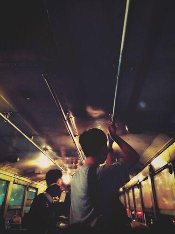 Real People Public Transportation Transportation Lifestyles Train - Vehicle Mode Of Transport Men Leisure Activity Night Women Illuminated Standing Indoors  Adult People Nightbus Colorful Worm Yellow Asian  Travel Bangkok Thailand. Public Transportation Sunset