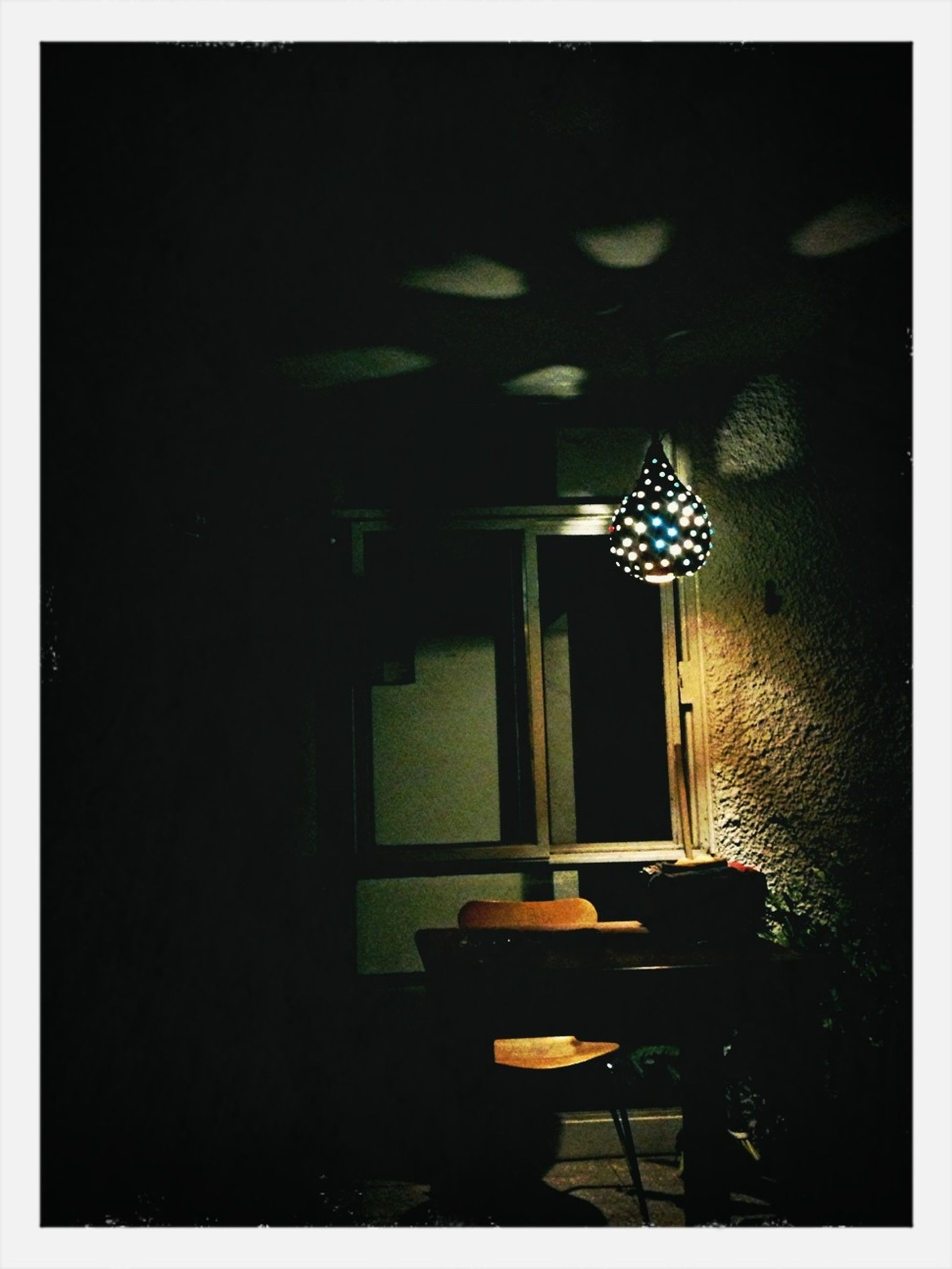 indoors, table, chair, absence, home interior, illuminated, empty, window, electric lamp, lighting equipment, house, domestic room, dark, architecture, home showcase interior, no people, auto post production filter, built structure, potted plant, furniture