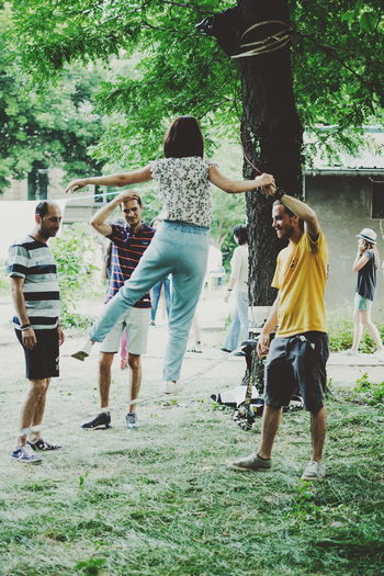 Casual Clothing Cooperation Day Enjoyment Friendship Fun Lifestyles Medium Group Of People Men Motion Outdoors People Playing Real People Slackline Togetherness Tree Walking Stories From The City Go Higher