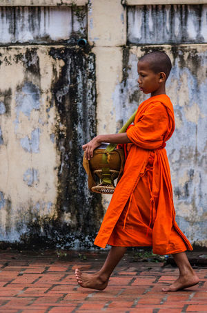 ASIA Best EyeEm Shot Buddha EyeEmNewHere Luang Prabang, Laos Alms Giving Architecture Barefoot Boys Buddhism Eyem Best Shots Laos Lifestyles Luang Prabang Orange Color Outdoors Religion Travel Destinations EyeEm New Here
