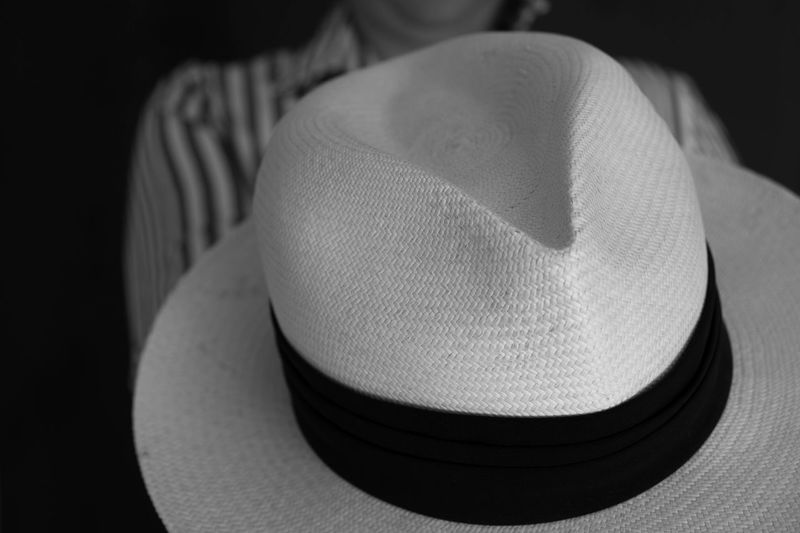 Close-up of hat against black background