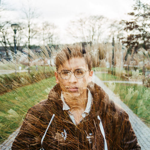 Double Exposure Multiple Exposures Adult Day Eyeglasses  Front View Glasses Hairstyle Headshot Leisure Activity Lifestyles Looking At Camera Mid Adult Women Nature One Person Outdoors Plant Portrait Real People Selfportrait Smiling Standing Teenager Warm Clothing Women