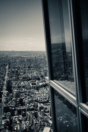 Aerial view of city seen through glass window