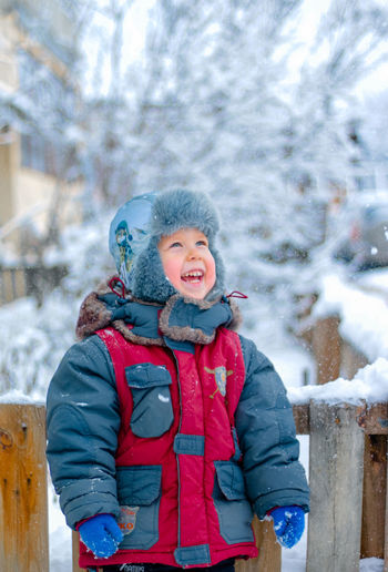 Portrait of a smiling boy in snow