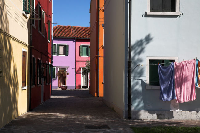 Colorful architecture of Burano island, in Venice, Italy Architecture Building Exterior Built Structure Burano, Italy Burano, Venice City City Life City Street Citylife Cityscape Colorful Colors Day Door Facades Hanging No People Orange Outdoors Pink Shadows Street Sunny Day Travel Destinations Window Art Is Everywhere Colour Your Horizn
