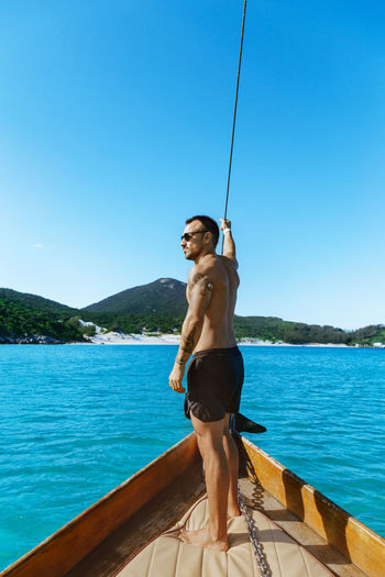 Water Sky One Person Young Adult Leisure Activity Nautical Vessel Nature Blue Day Lifestyles Beauty In Nature Clear Sky Full Length Mountain Transportation Real People Sea Outdoors