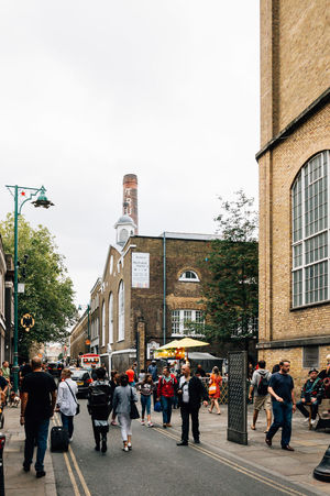 Brick Lane market in London Adult Adults Only Architecture Brexit Brick Lane Building Exterior City City City Life Day Flea Market Large Group Of People Life London London Life London Lifestyle Market Men Outdoors People Real People Sky Street Urban Women