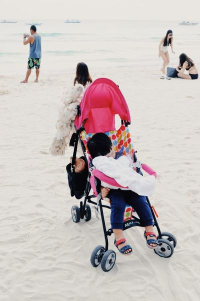 beach scene, boracay EyeEmNewHere Baby Tourism Philippines Boracay Sand Full Length Real People Beach Togetherness Vacations Day Men Lifestyles Outdoors People Childhood Sitting EyeEmNewHere