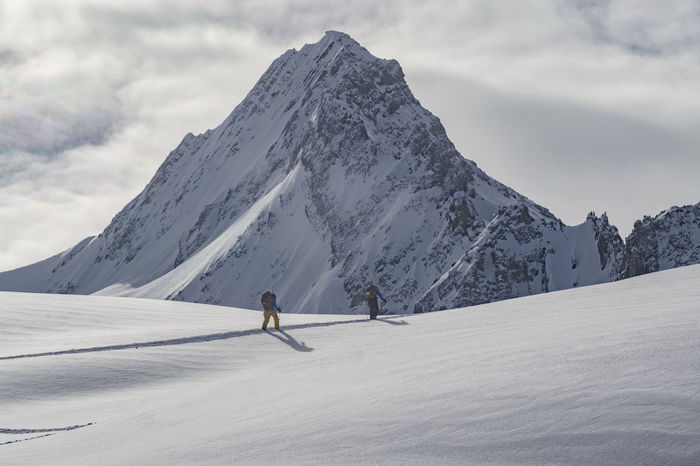 Adventure Ascending Backcountry Backcountry Skiing Climbing Cloud - Sky Cold Temperature Extreme Sports Fresh Landscape Leisure Activity Lifestyles Mountain Mountain Range Outdoors Powder Rugged Ski Holiday Skiing Snow Snowcapped Mountain Sport Untracked Vacations Winter The Great Outdoors - 2017 EyeEm Awards Go Higher