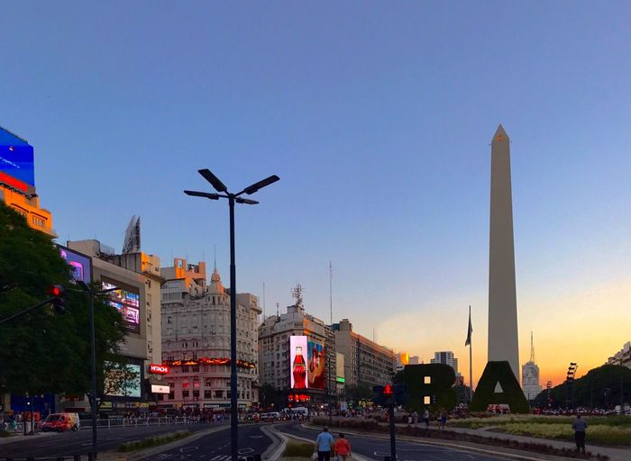 Obelisco, Buenos Aires 🌆 Obelisk Cityscape Urban Skyline Landmark Capital Cities  Old Architecture Architecture Building Exterior Built Structure City Transportation Road Clear Sky No People Outdoors Travel Destinations Sky Illuminated Bridge - Man Made Structure Day