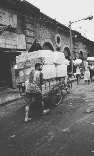 One of the streets of kolkata, the City of Joy where people work hard the whole day with their smile never leaving their face. Full Length Transportation Mode Of Transport Land Vehicle Outdoors Real People Day Men Occupation Long Shot Kolkata KolkataStreets India EyeEm Selects EyeEm The Week On EyeEm EyeEm Best Edits