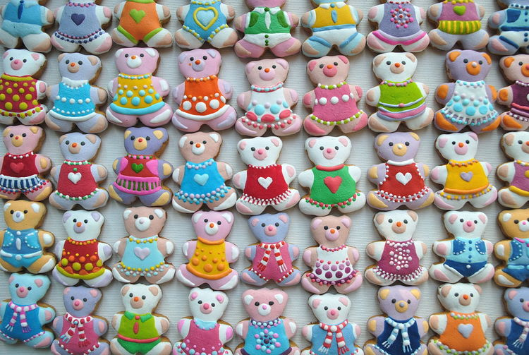 Directly above shot of colorful teddy bear shape christmas cookies at market stall