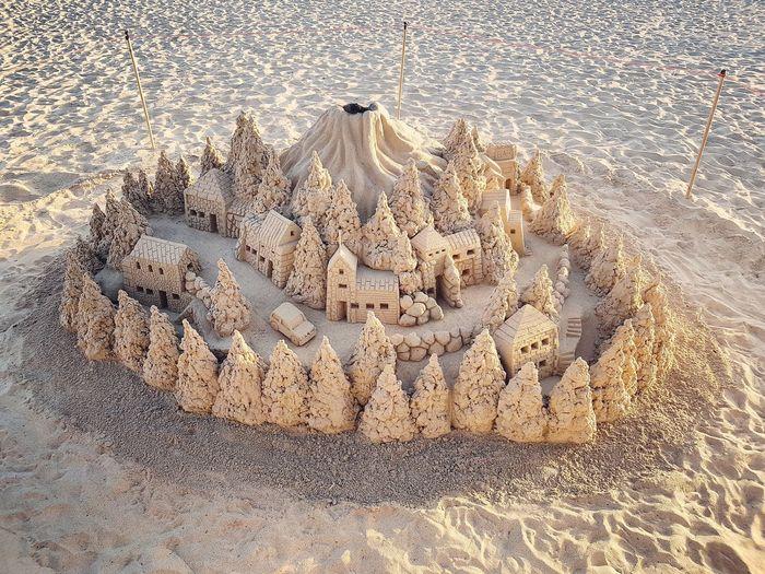 Sandcastle Building Sandcastles On The Beach. Sandcastle Sand Full Frame Pattern Close-up