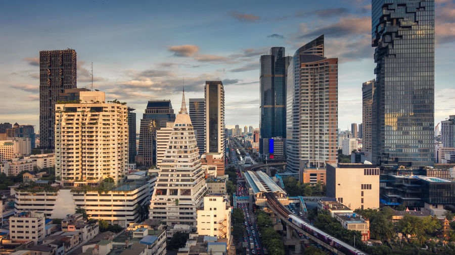 Bangkok city skyline and business district of Thailand. Building Exterior Built Structure Architecture City Building Office Building Exterior Cityscape Sky Skyscraper Tall - High Cloud - Sky Office Tower High Angle View Urban Skyline Modern Nature Residential District Landscape No People Outdoors Financial District  Bangkok Thailand Twilight