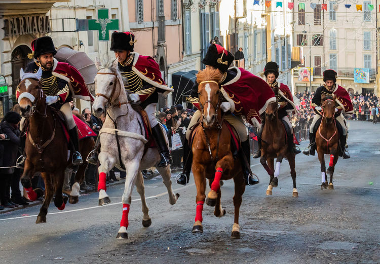 traditional galloping of hussars during the carnival of Ronciglione Italy🇮🇹 Carnival Ussari Ronciglione Trot Animal Team Passion Tradition EyeEm Gallery Tree Sports Race Competition Gambling Men Horse Racing Competitive Sport Riding Horseback Riding Horse Horsedrawn