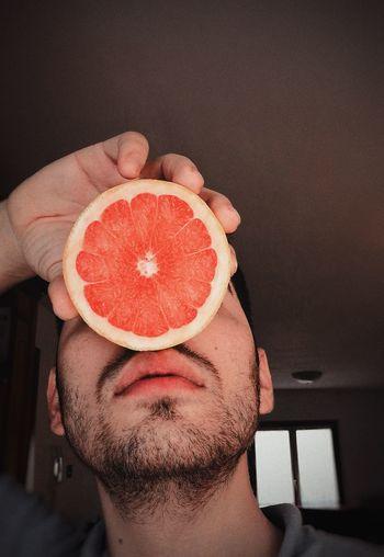 Close-up of man holding fruit