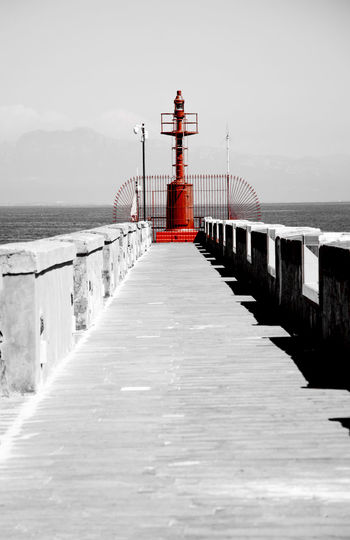 View of pier over sea against sky