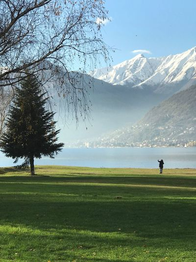 Scenic view of lake against snowcapped mountain