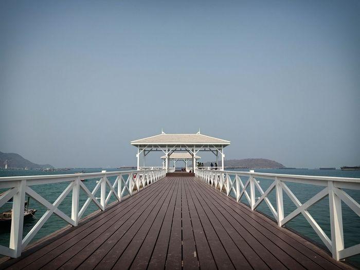 Pier against clear blue sky