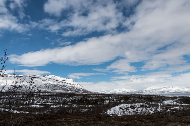 Mountains Abisko 4 Abisko Beauty In Nature Blue Cloud - Sky Cold Temperature Day Frozen Glacier Iceberg Landscape Mountain Mountain Range Nature No People Outdoors Scenics Sky Snow Snowcapped Mountain Sweden Tranquil Scene Tranquility Water Weather Winter