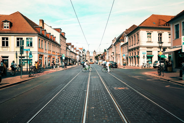 Tramway in city against sky
