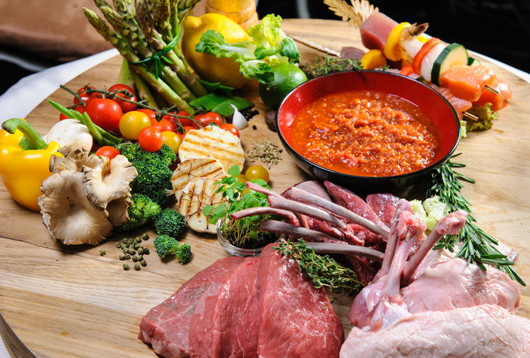 Abundance of raw meat and vegetables on a wooden board Beef Ingredients Lamb Pork Raw Meat   Beef Chicken Fillet Close-up Cutting Board Fillet Food Food And Drink Healthy Eating Indoors  Meat No People Paprika Preparation  Raw Chicken Raw Food Steak Tomato Variation Vegetable Wooden Board