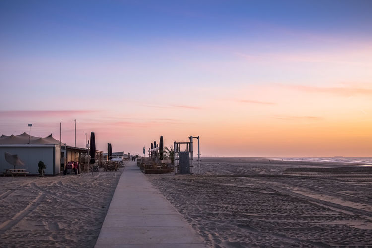 Evening beach of peace Kijkduin Strand Beach Beauty In Nature Day Hollandse Strand Kijkduin Strand Nature No People Outdoors Sand Scenics Sea Sea Hut Sky Sunset The Way Forward Tranquil Scene Tranquility Water
