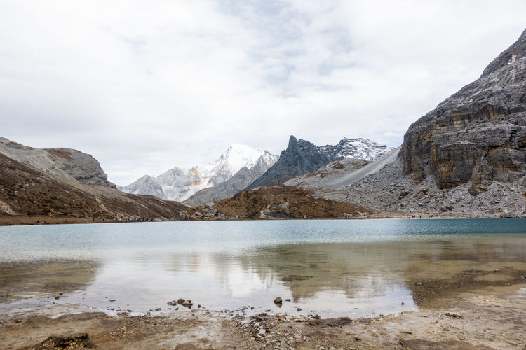 Milk Lake Yarding Mountain Water Sky Scenery Environment Lake Wilderness Landscape Beauty In Nature Nature Cold Temperature Reflection Scenics - Nature Snow Mountain Peak Outdoors No People Rock Range High Height Mountain Range