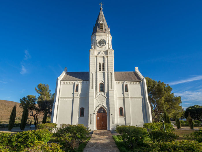 Church Little Karoo South Africa Architecture Bell Tower Blue Building Exterior Built Structure Cloud - Sky Cross Day History Karoo Low Angle View Nieu-bethesda No People Outdoors Place Of Worship Religion Sky Spirituality Travel Destinations Tree