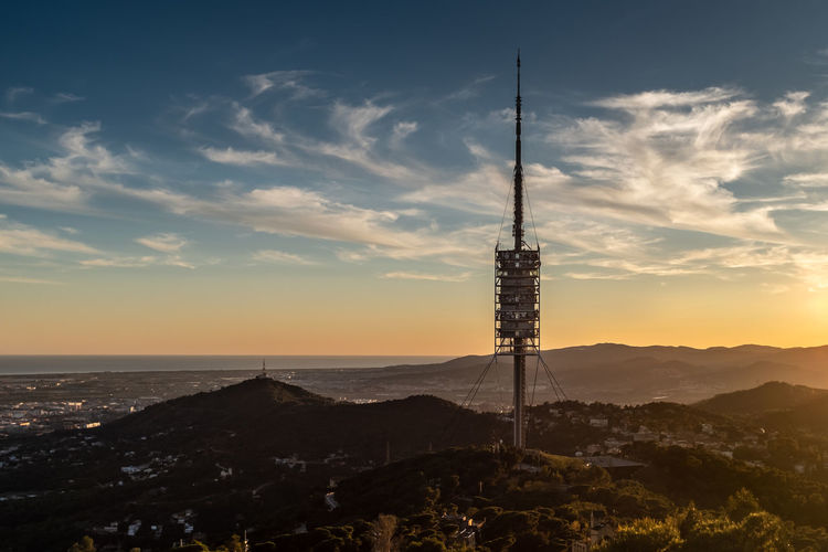 Communications tower against sky during sunset. barcelona, spain.