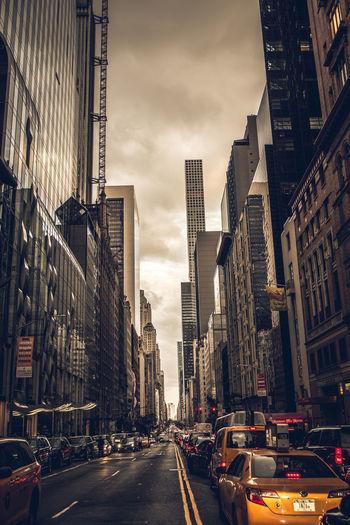 City street amidst buildings against sky