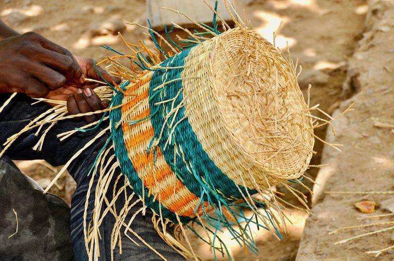 Art And Craft Ghana Africa Art Art Market Basket Basket Weave Braid Close-up Finger Focus On Foreground Hand Holding Human Body Part Human Hand Outdoors Talent Weaver Weaving