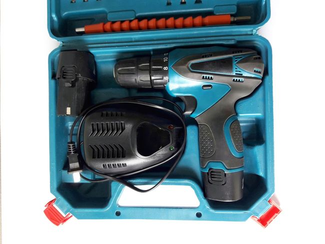 electric drill in blue box Technician Handcraft Industry Industrial Electric Drill Bluebox Craftsman Tool Equipment Instrument Electrical Power Bore Work Penetrated Technology Close-up Manufacturing Equipment Industrial Equipment Metal Industry Steel Mill Drilling Rig Machine Part