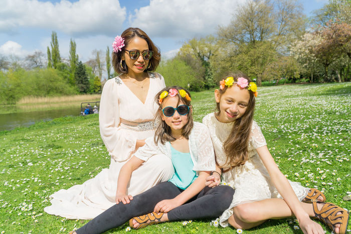 Mother and daughters interacting in a local park in the springtime. Blur Background Children Cloudy Sky Family Females Filipino Mother Flowers Green Happy Lake View Lush Foliage Model Modeling Mother + Two Daughters One Person Out Outdoors Park Sisters ❤ Smiles Springtime Water