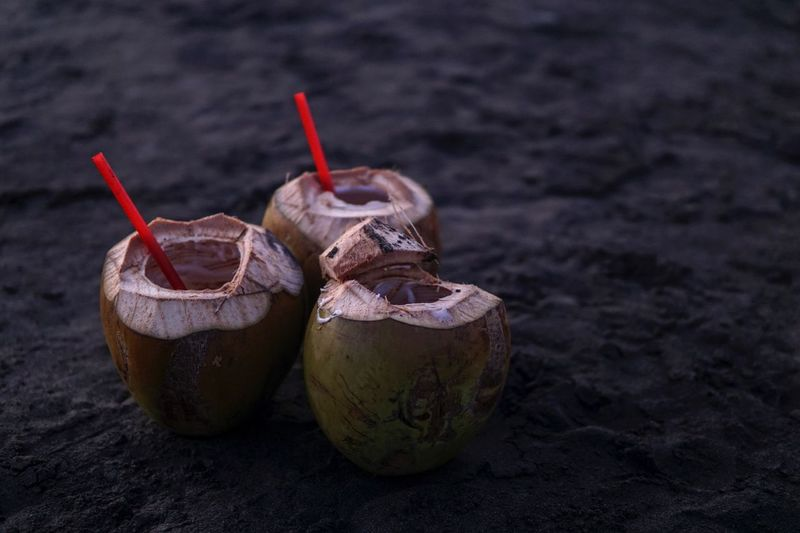 Coconut water at sandy beach