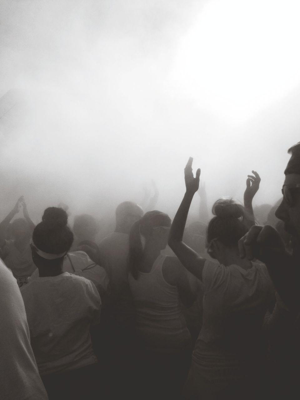 People Dancing In Music Concert