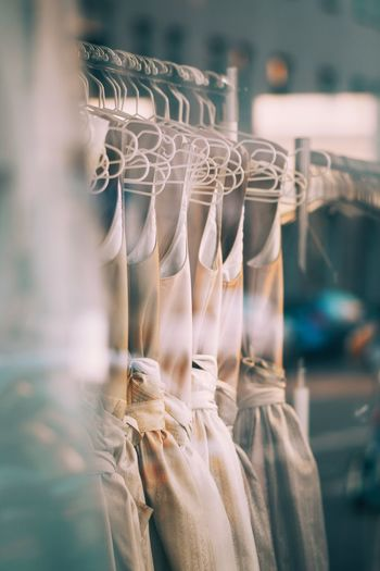 Close-up of clothes hanging on display at store